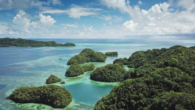 vidéos et rushes de ws aerial view of the rock islands / koror, palau - south pacific ocean