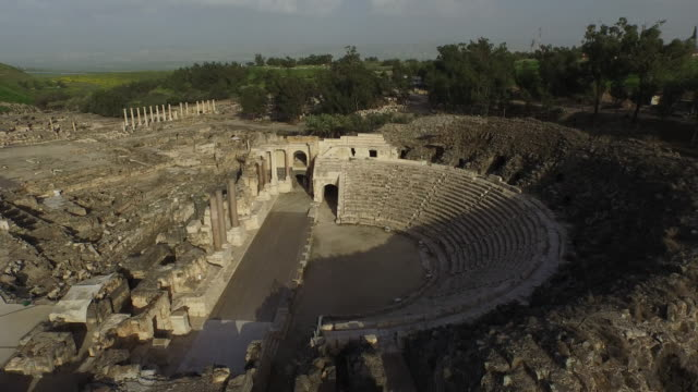 aerial view of the roman theatre in the ancient roman city beit she'an, israel. - israele video stock e b–roll