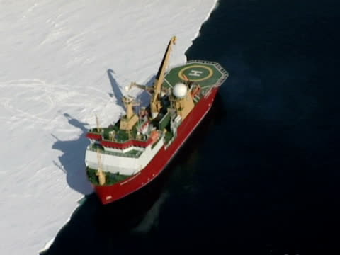 aerial view of the rrs ernest shackleton by pack ice in the weddell sea, at the brunt ice shelf, antarctica. (ntsc pal 4x3 anamorphic; h264 mpeg4 16x9 square) audio available on masters. not available to clients based in uk. - ernest shackleton stock videos & royalty-free footage