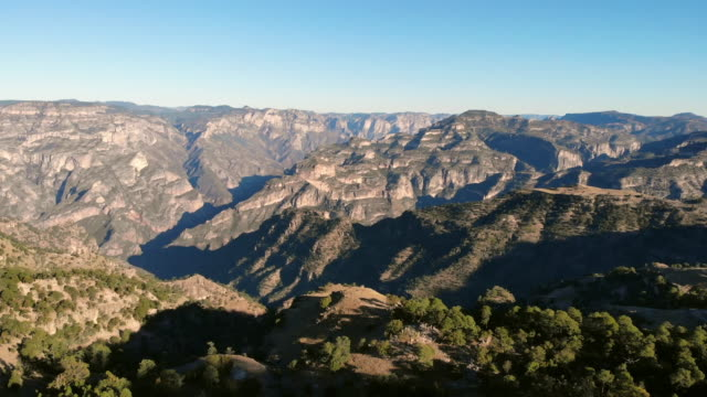 aerial view of the rugged landscape and village of cieneguita, chihuahua mexico in the summer time near the dramatic copper canyon area in the sierra madre mountains - sierra madre stock videos & royalty-free footage