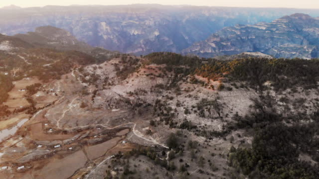 aerial view of the rugged landscape and village of cieneguita, chihuahua mexico in the summer time near the dramatic copper canyon area in the sierra madre mountains - chihuahua stock videos & royalty-free footage
