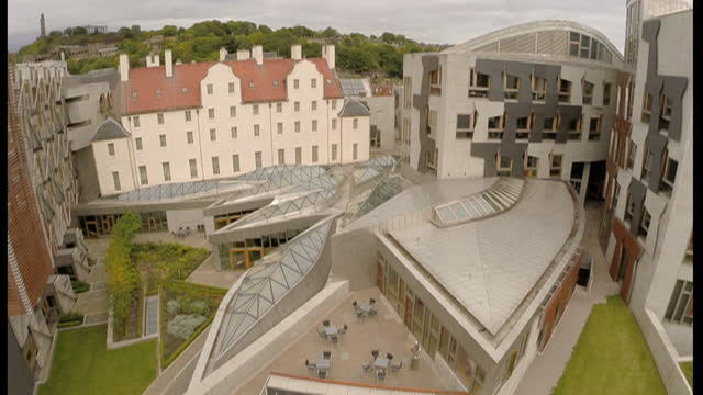 aerial view of the scottish parliament building - politics stock videos & royalty-free footage