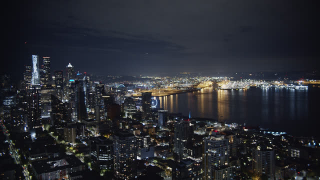 aerial view of the seattle skyline and puget sound (elliott bay) at night - general view stock videos & royalty-free footage
