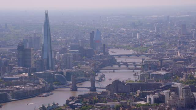 aerial view of the shard and tower bridge, london, uk. 4k - shard london bridge stock videos & royalty-free footage