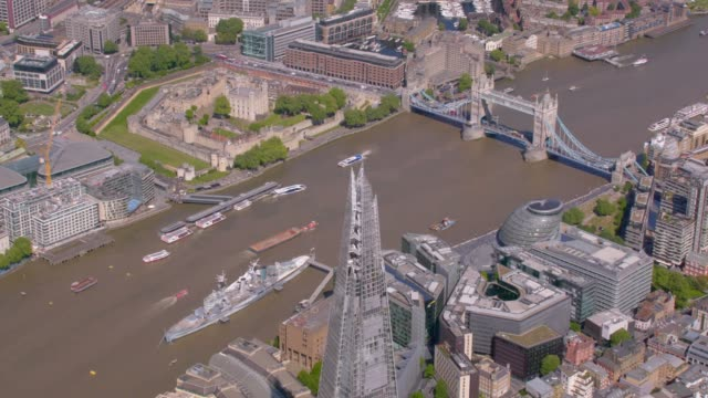 aerial view of the shard and tower bridge london, uk. 4k - tower bridge stock videos & royalty-free footage
