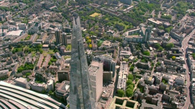 aerial view of the shard london bridge, uk. 4k - paesaggio urbano video stock e b–roll
