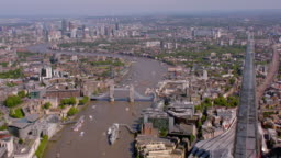 Aerial View of The Shard, the River Thames and Tower Bridge, UK. 4K