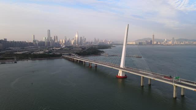 aerial view of the shenzhen bay bridge and shenzhen skyline / shenzhen, china - westernisation stock videos & royalty-free footage