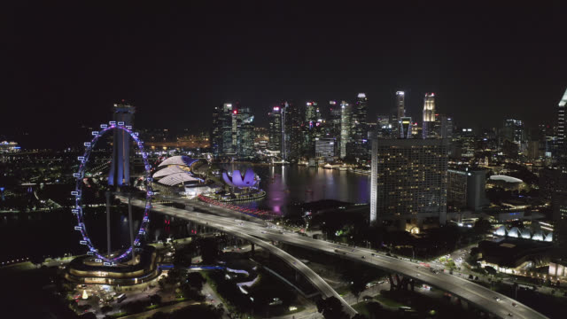 aerial view of the singapore landmark financial business district at night - laser stock videos & royalty-free footage