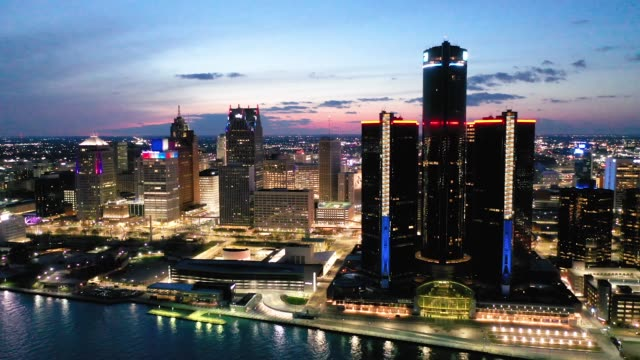 aerial view of the skyline on april 16, 2020 in detroit, michigan. landmarks and buildings across the nation are displaying blue lights to show... - detroit michigan stock videos & royalty-free footage