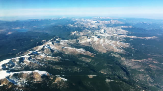 aerial view of the snowcapped rocky mountains of colorado - rock stock videos & royalty-free footage