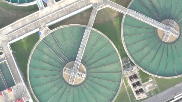 aerial view of the solid contact clarifier tank type sludge recirculation in water treatment plant - storage tank stock videos & royalty-free footage