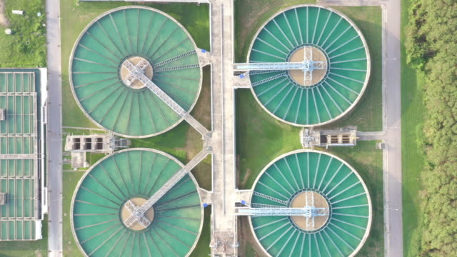 aerial view of the solid contact clarifier tank type sludge recirculation in water treatment plant in factory. industry and environment factory for ecology concept. - concrete stock videos & royalty-free footage