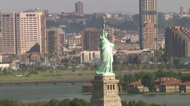 aerial view of the statue of liberty in new york city, usa - symbol stock videos & royalty-free footage