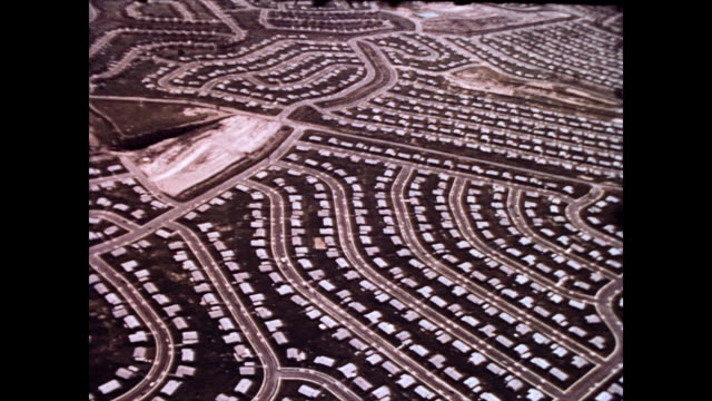 / aerial view of the suburb levittown / uniformity of street design and size of housing development can be seen aerial view of levittown pa suburbs... - suburban stock videos & royalty-free footage