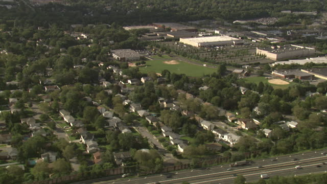 aerial view of the suburbs, long island, new york, usa - long island video stock e b–roll