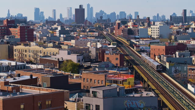 aerial view of the subway train passing on the elevated railroad in brooklyn, new york. aerial drone-made 4k uhd b-roll footage with the complex... - elevated train stock videos & royalty-free footage