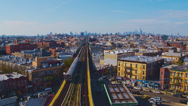 aerial view of the subway train passing on the elevated railroad in brooklyn, new york. 4k uhd b-roll footage with the static camera. - elevated train stock videos & royalty-free footage