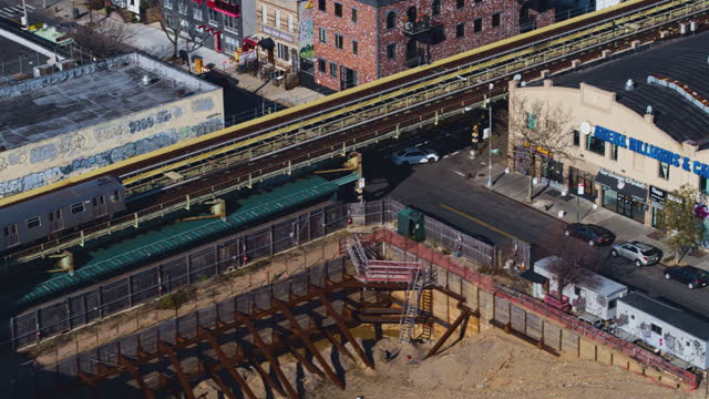 aerial view of the subway train passing on the elevated railroad in brooklyn, new york. 4k uhd b-roll footage with the complex cinematic... - elevated train stock videos & royalty-free footage