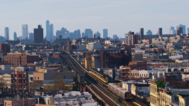 aerial view of the subway train passing on the elevated railroad in brooklyn, new york. aerial drone-made 4k uhd video footage. panoramic-orbiting... - elevated train stock videos & royalty-free footage