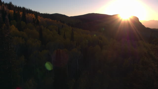 aerial view of the sun setting on a beautiful mountainside in the fall. - american fork city stock videos & royalty-free footage