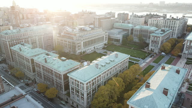aerial view of the sun setting over columbia university - landscaped stock videos & royalty-free footage
