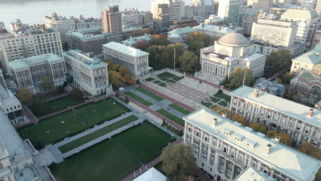 aerial view of the sun setting over columbia university - river hudson stock videos & royalty-free footage