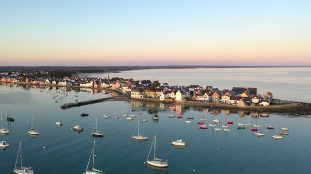 """aerial view of the sunset in loctudy in the front of """"perdrix"""" lighthouse - france stock videos & royalty-free footage"""