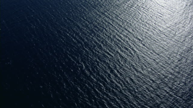 aerial view of the surface of the pacific ocean with small waves. - pacific ocean stock videos & royalty-free footage