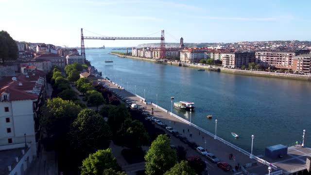 vídeos y material grabado en eventos de stock de aerial view of the suspension bridge, vizcaya bridge in portugalete - chain bridge suspension bridge