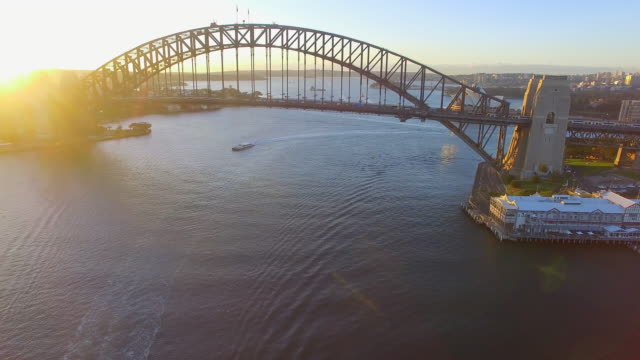 aerial view of the sydney harbour bridge at sunrise - david ewing stock videos & royalty-free footage