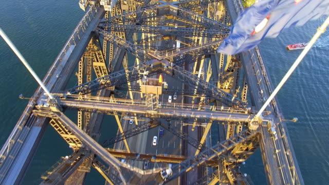 vídeos y material grabado en eventos de stock de aerial view of the sydney harbour bridge at sunrise - david ewing