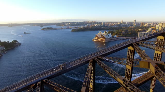 aerial view of the sydney harbour bridge at sunrise - オペラ座点の映像素材/bロール