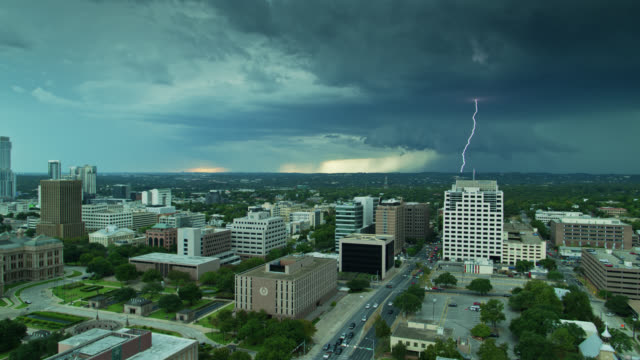 aerial view of the texas state capitol building and downtown austin with dramatic storm on horizon - texas state capitol building stock videos & royalty-free footage