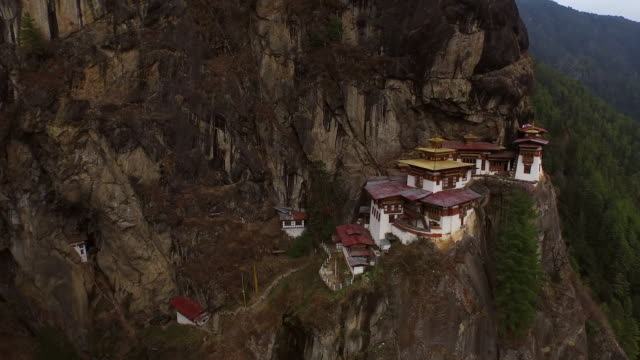 aerial view of the tigers nest monastery on the side of a cliff two - bhutan stock videos & royalty-free footage