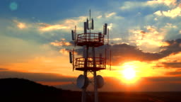 Aerial view of the top of telecommunication tower against scenic sunset
