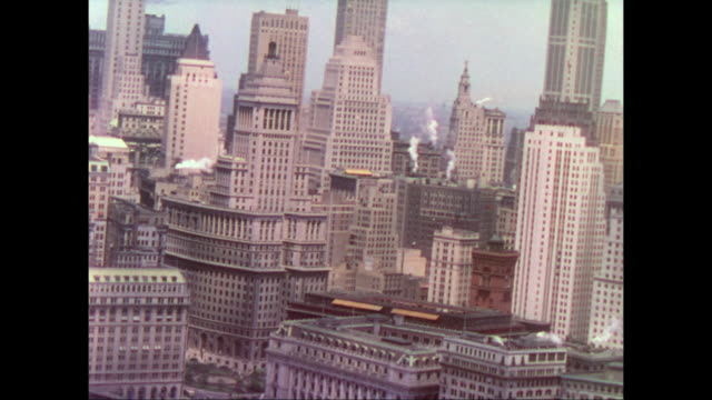 vidéos et rushes de 1937 aerial view of the tops of the new york city's skyscrapers - usa mid atlantic