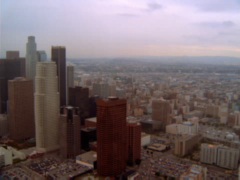aerial view of the towers of the downtown los angeles business district. - artbeats stock videos & royalty-free footage