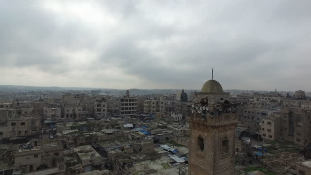 aerial view of the town from behind the minaret of the 12th century great mosque of maarat al-numan, which suffered severe damage in the syrian civil... - circa 12th century stock videos & royalty-free footage
