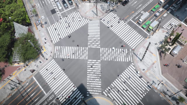 aerial view of the traffic on intersection, people crossing the road - ginza stock videos & royalty-free footage