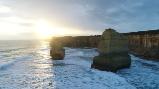 aerial view of the twelve apostles in australia - water's edge stock videos & royalty-free footage