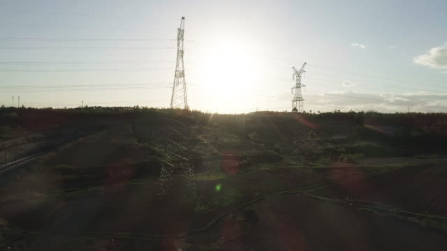 aerial view of the ultra-high voltage power transmission tower - flugzeugperspektive stock-videos und b-roll-filmmaterial