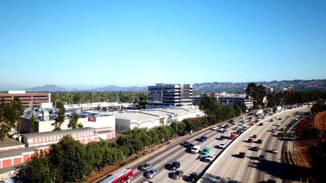 4K Aerial view of the valley and 405 freeway and traffic