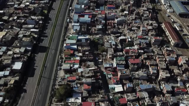 aerial view of the villa 31 slum and the 25 de mayo highway on april 14, 2020 in buenos aires, argentina. national government extended obligatory... - buenos aires stock videos & royalty-free footage