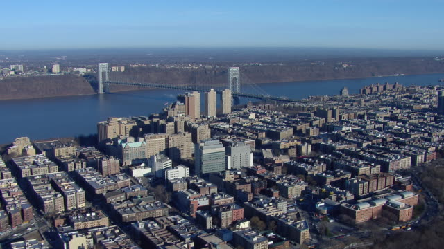 aerial view of the washington heights neighborhood and the george washington bridge on the hudson river in new york city. - manhattan stock videos & royalty-free footage