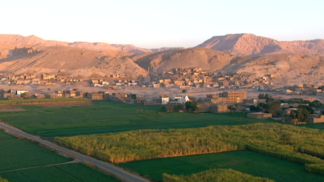 aerial view of the west bank of the nile opposite luxor. - tempio di hatshepsut video stock e b–roll