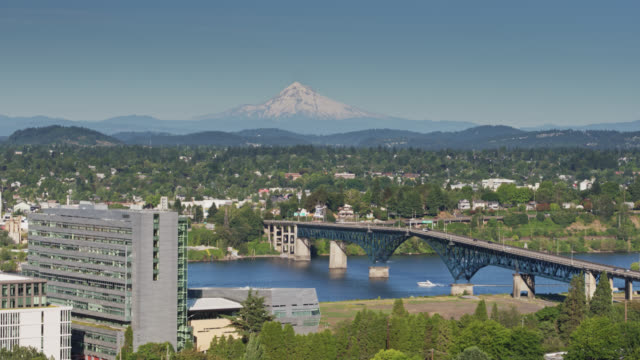 aerial view of the willamette river and se portland with mt hood in distance - mt hood stock videos & royalty-free footage