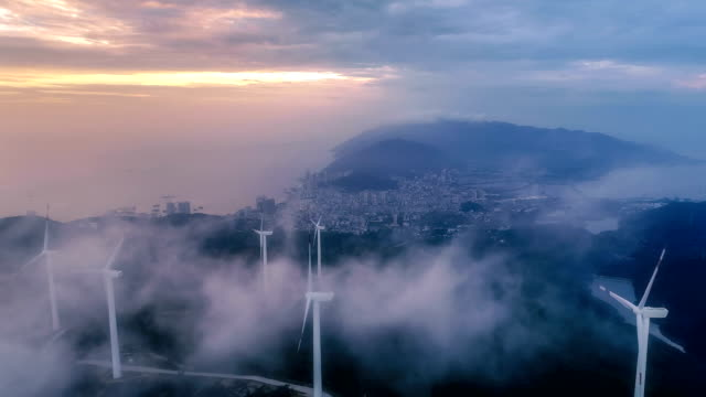 vídeos de stock e filmes b-roll de aerial view of the windmill in fog - sustainable resources
