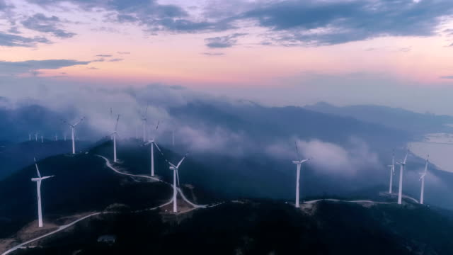 aerial view of the windmill in fog - power supply stock videos & royalty-free footage
