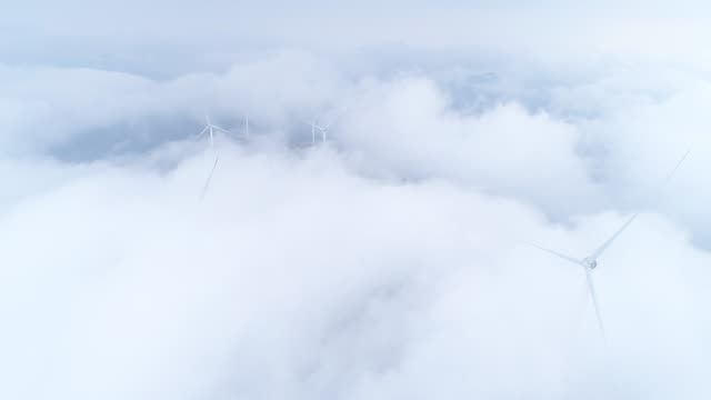 aerial view of the windmill in fog - turbine stock videos & royalty-free footage